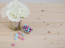 Bath Time color tablets on wood background. Bath Time color tablets for kids on wood background with bunch white flowers royalty free stock photos