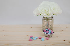Bath Time color tablets on wood background. Bath Time color tablets for kids on wood background with bunch white flowers royalty free stock images