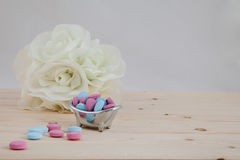 Bath Time color tablets on wood background. Bath Time color tablets for kids on wood background with bunch white flowers royalty free stock photo