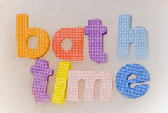 Bath time foam letters. In bubbles Royalty Free Stock Image
