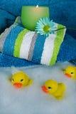 Bath Time Fun. Rubber ducks in a bubble bath stock images