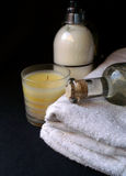 Bath time Luxury. Cream and candle and massage oil for a luxurious bath time or spa session of pampering Royalty Free Stock Photos