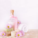 Bath Toiletries with Flowers and Candles Stock Photos