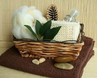 Bath tools in wooden basket and towel Stock Image