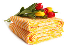 Bath towel with fresh tulips Royalty Free Stock Photography