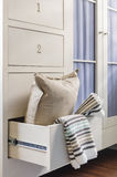 Bath towel and pillow in wardrobe Royalty Free Stock Photo