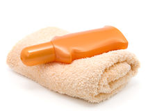 Bath towel and plastic bottle Stock Images