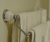 Bath Towel Rack. A chrome and white bath towel rack with two towels hanging from it Royalty Free Stock Photography