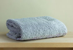 Bath towel on table Royalty Free Stock Images