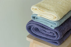 Bath towel on table Stock Images