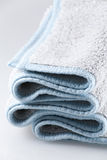Bath Towels. A bath mat with blue details Royalty Free Stock Photo
