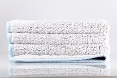 Bath Towels. A bath mat with blue details Royalty Free Stock Images