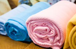 Bath towels. Closeup of colorful bath towels, rolled and piled Stock Image