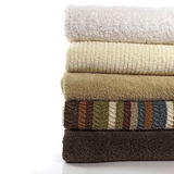 Bath Towels 2. Folded stack of  5 fresh bath towels with solids and one stripe on white Royalty Free Stock Photo