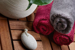Bath towels. On wood table with a washing stone Stock Photography