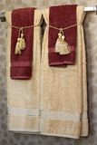 Bath towels. Beautiful bath towels with golden tassels Stock Photos