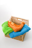 Bath Towels. Mixed color bath towels in a square basket isolated on white background Stock Image