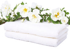 Bath towels. With rose on white background Stock Photo