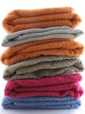 Bath Towels. Of different colours piled on top of one another royalty free stock photo