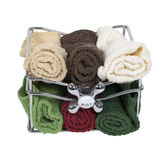 Bath Towels in a Basket with Faucet Handle Stock Image