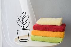 Bath towels of different colors stock image