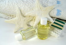 Bath towels with natural oils and starfish Royalty Free Stock Photo