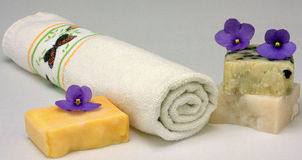 Bath towels and natural soap Stock Images