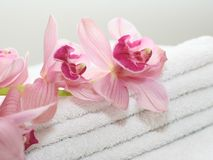 Bath towels with orchids. Bath accessories isolated towels and orchids Stock Photo