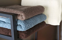 Bath towels in a shelf. Stock Image