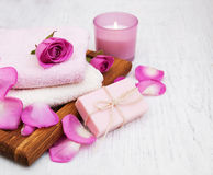 Bath towels and soap with pink roses Royalty Free Stock Photography