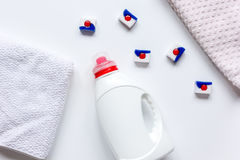 Bath towels stack with detergent bottle in laundry light background top view stock photos