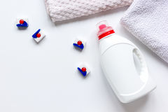 Bath towels stack with detergent bottle in laundry top view mockup. Bath towels stack with detergent plastic bottle in laundry on light table background top view Stock Photos