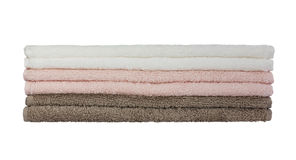 Bath towels in stack isolated over white Stock Photography