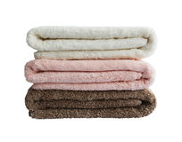 Bath towels in stack isolated. Bath towels in stack. White, pink, brown. isolated Stock Images