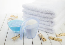 Bath towels, washing powder, fabric softener and wooden clothesp Stock Images