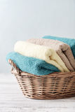 Bath towels in wicker basket Stock Images