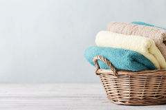 Bath towels in wicker basket Royalty Free Stock Images