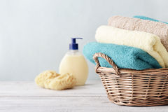 Bath towels in wicker basket Stock Photo