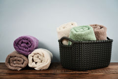 Bath towels in wicker basket Stock Images