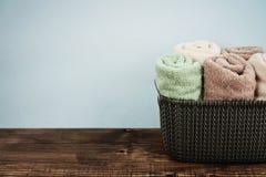 Bath towels in wicker basket Royalty Free Stock Photo