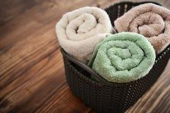 Bath towels in wicker basket Royalty Free Stock Photos