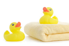 Bath towels and Yellow rubber duckies Royalty Free Stock Images