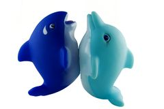 Bath toys. Blue orca and turquoise dolfing on tails Royalty Free Stock Photography