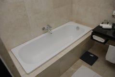 Bath tub. A bath tub with a modern interior design stock image