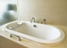 Bath tub. White bath tub in house stock image