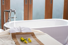 Bath tub. Luxury bath tub and faucet in spa room royalty free stock photo