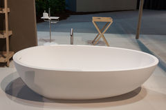 Bath tub on display at HOMI, home international show in Milan, Italy. MILAN, ITALY - SEPTEMBER 13: Bath tub on display at HOMI, home international show and point stock photography