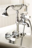Bath tub faucet. Faucet on an antique bath tub Royalty Free Stock Image