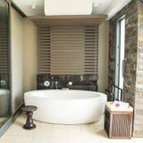Outdoor bathtube in luxury resort in tropes, Hotel Intercontinental, Natadola Beach, Fiji. Bath tube on patio in luxury Hotel and Resort Intercontinental stock image