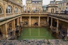 Roman Baths, public bath house in Roman period. BATH, UK - DECEMBER 13 2017: Tourists visiting inside the Roman Baths on December 13,2017 in Bath, UK Royalty Free Stock Images